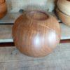 Le fond de ce bol en bois présente une empreinte en queue d'arronde, technique classique de tournage sur bois